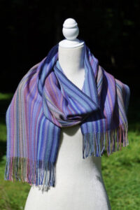 Hand woven alpaca scarf in blues.