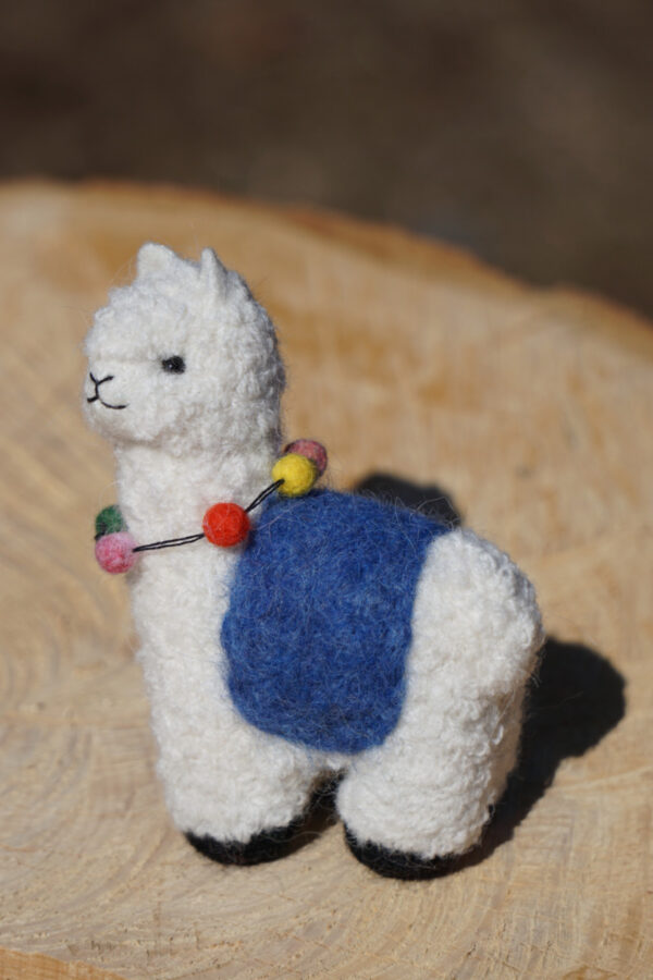 Hand felted 4 1/2 and 8 inch tall alpaca pals.